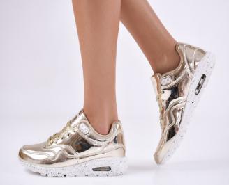 Дамски спортни обувки  златисти